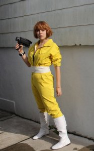 April O'Neill: How To 1: Yellow jumpsuit or track suit 2: 80's style white boots 3: White belt 4: Red bobbed wig