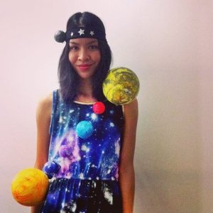 1: All black outfit 2: different sizes of foam balls painted to resemble the planets. string them together like a sash.